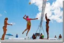 Scott McIntyre/Staff Gretchen Dufner goes up for a spike while Larisa Witherspoon goes up to block it during their match in the Extreme Volleyball Professionals Island Holiday Women's Tour event at Vanderbilt Beach on Saturday.